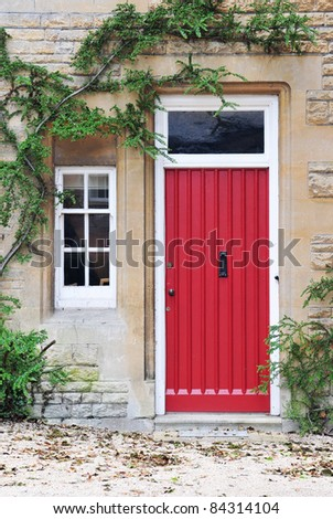 Front Door of an Old English Cottage House - stock photo