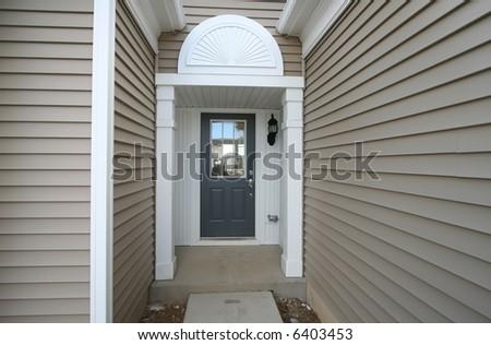 Front door of new home - stock photo
