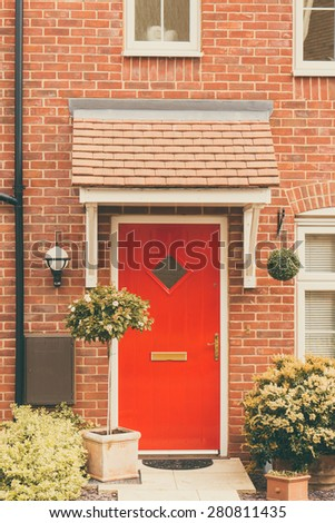 Front door of newly built house closeup - stock photo