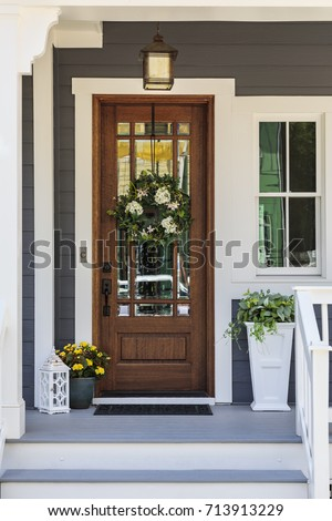 Front door with a decorative wreath