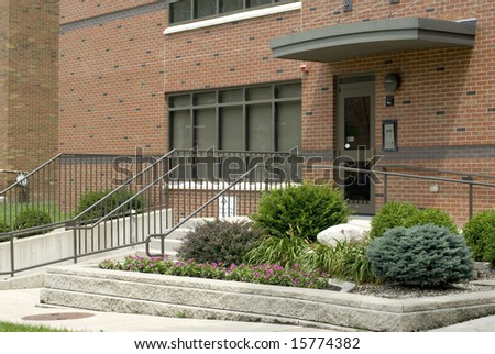 Front door with stairs and handicap accessibility. - stock photo