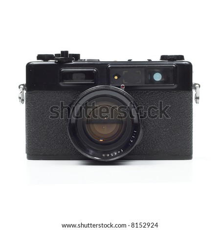 Front elevation view of old, seventies-style range-finder camera isolated on white background