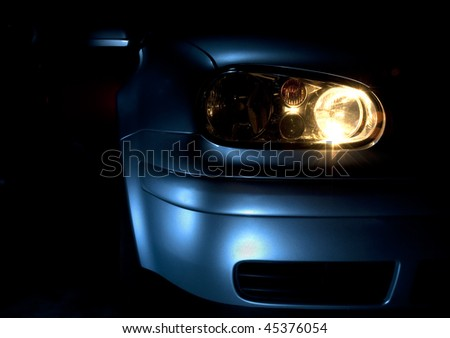 Front end and light of a blue car - stock photo
