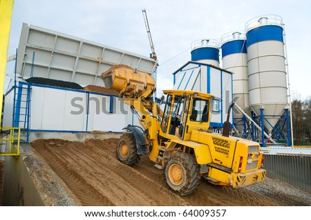 front-end loader loading with sand bunker of Stationary Concrete Batching Plant - stock photo