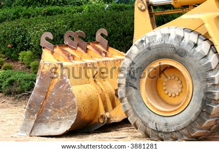 Front end of a heavy piece of road equipment - stock photo