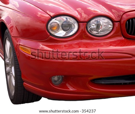 Front end of a red spots car isolated over white background - stock photo