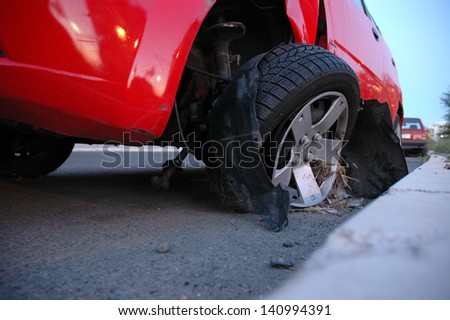 Front end of a vehicle after a car accident - stock photo