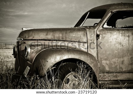Front end of an old rusty 1940's truck - stock photo