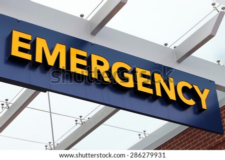 Front entrance sign to an emergency room department in a city hospital.