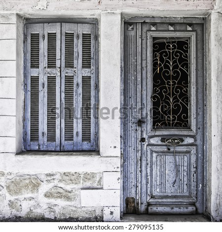 Front entrance to an abandoned proberty on the Greek island of Crete. - stock photo
