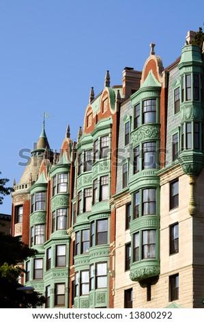 Front exterior of Boston Mansion with elegant verdigris patina on bay windows - stock photo