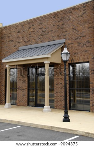 Front Facade of a New Brick Office Building - stock photo