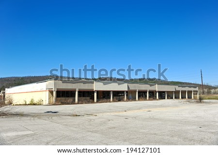 Front Facade of an Abandoned Commercial Building - stock photo