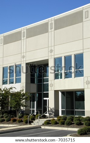 Front Facade of New Commercial Office Building - stock photo