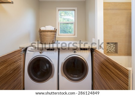 Front load washer and dryer with open wooden closet. Great design idea when there is no laundry room. - stock photo