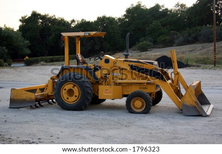 Front Loader Construction Machinery Side View - stock photo