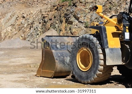Front loaders in quarry - stock photo