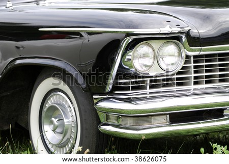 Front of a black old timer. - stock photo