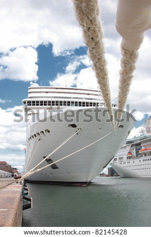 front of a cruise ship docked at a port in Norway - stock photo