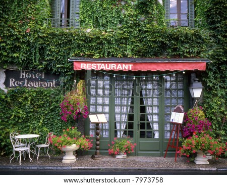Front of a French restaurant with menu boards