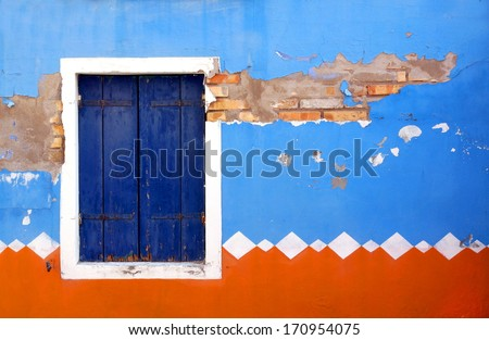 front of a house painted in traditional patterns and colors   - stock photo