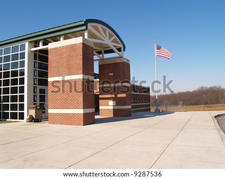 front of a modern red brick building - stock photo