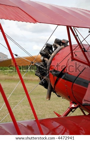 Front of a restored, red, 1941 bi-plane. - stock photo