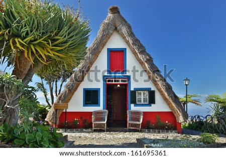 Front of a Traditional cottage in Santana  Madeira, Portugal - HDR image - stock photo