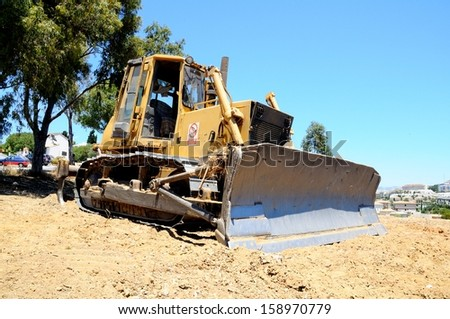 Front of a yellow bulldozer showing the blade tool, Costa del Sol, Andalusia, Spain, Western Europe.