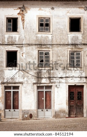 Front of abandoned building with two floors