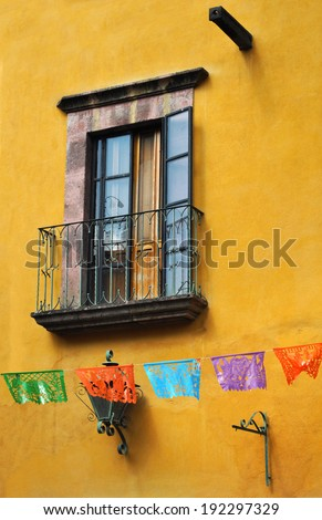 Front of an old mexican house - Colonial style window - San Miguel de Allende Mexico - stock photo