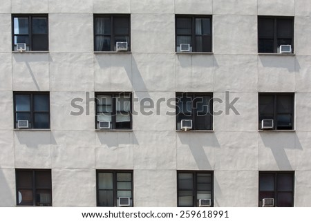 front of an old office building with air conditions hanged on windows, Manhattan, New York - stock photo