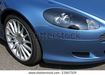 front of blue modern sports car headlight - stock photo