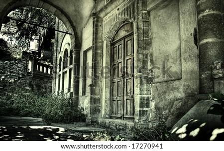 Front of creepy haunted house - stock photo