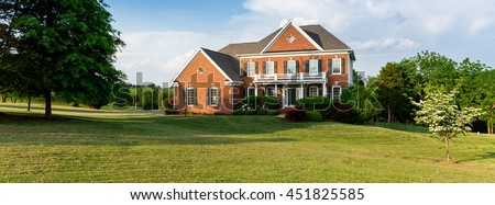 Front of home and garage of large single family modern US house ideal for social media page of realtor. Sized to fit a cover photo placeholder