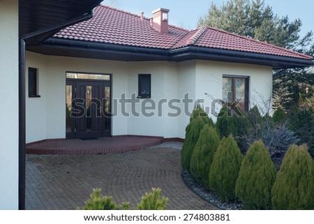 Front of luxury parter villa - stock photo