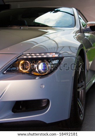 Front of new silver luxury car - stock photo