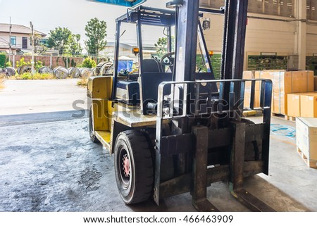 Front of old forklift vehicle used in industrial warehouse. It is also called lift or fork truck.