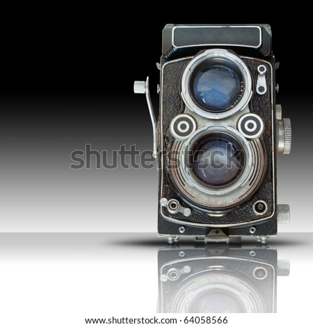 Front of Old twin lens reflect camera on white reflect floor - stock photo