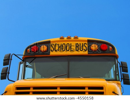 Front of School Bus Under Blue Sky - stock photo