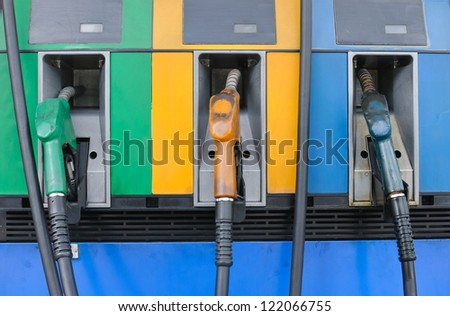Front of Three Gas Pump Nozzles at Gas Station Ready to work