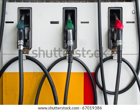 Front of Three Gas Pump Nozzles at Gas Station Ready to work - stock photo