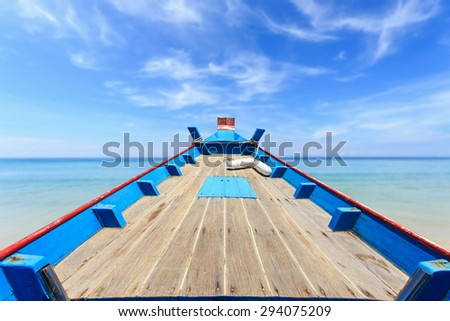 Front of traditional Thai boat and view of tropical sea with blue sky