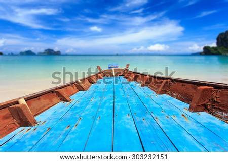 Front of traditional Thai boat and view of tropical sea with blue sky - stock photo