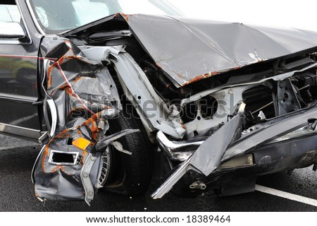 Front of wrecked automobile - stock photo