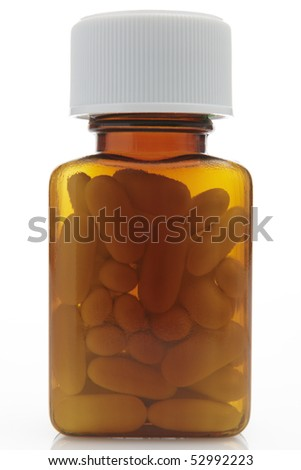 front on view of pills in a bottle on white background