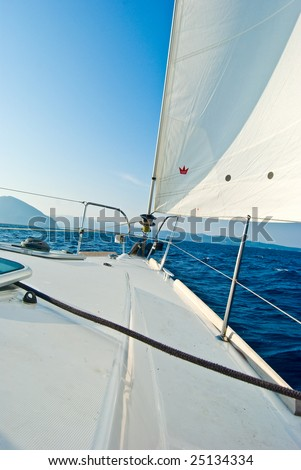Front part of a sailboat, set on full sails in Ionian sea