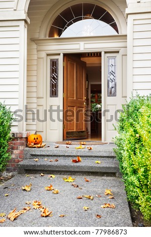 open front door. front path steps and open door with fall leaves jacko