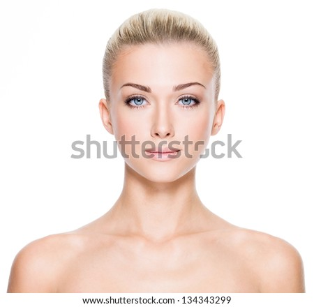 Front portrait of beautiful young woman with beautiful blue eyes and face - on white background - stock photo