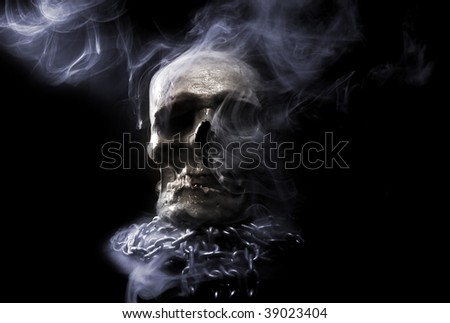 front real skull with chain in abstract smoke - stock photo